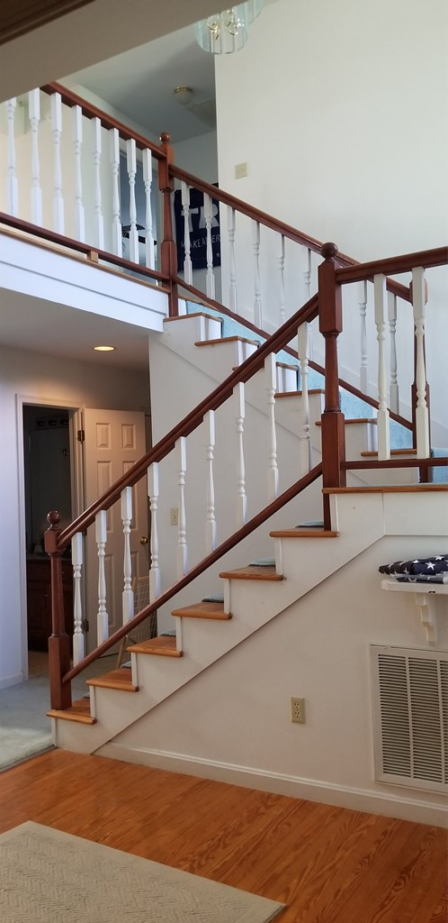 open staircase to the loft and 3 bedrooms
