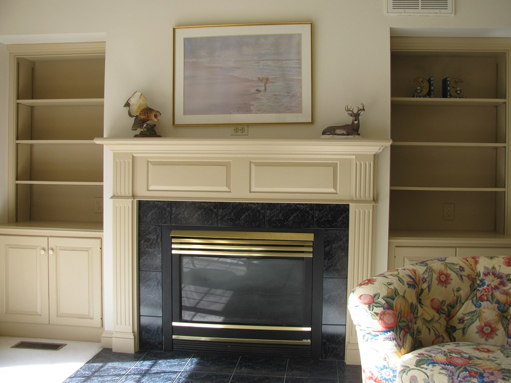 View of gas log fireplace and built-ins