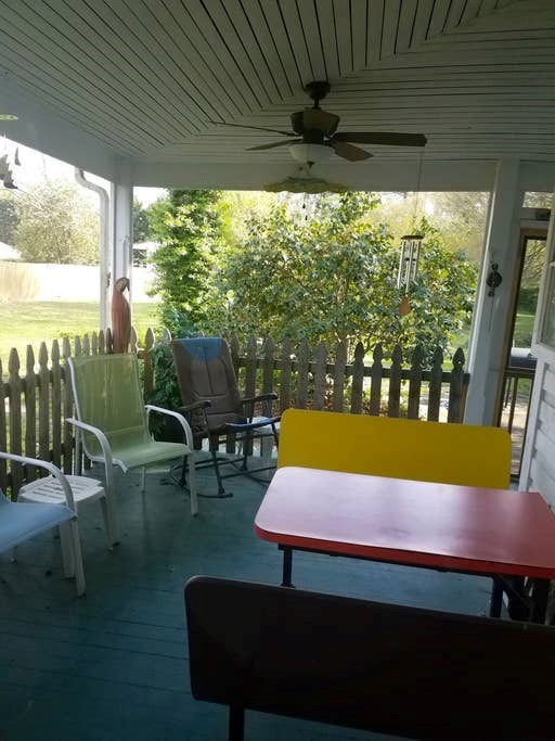 Covered porch off kitchen and sun parlor